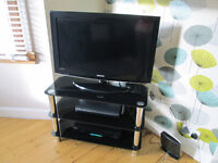 """BLACK GLOSSY GLASS TV STAND WITH CHROME LEGS - 32"""" (POSS 34"""") GC"""