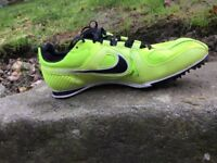 Ladies Nike Track and Field trainers. Size 6.5, Spikes, rench and bag included