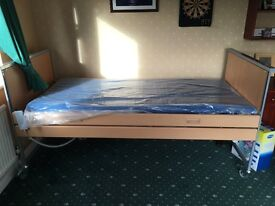 Adjustable bed - Invacare Medley homeware bed with contour mattress. Secondhand but never used