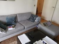 Sofa with footstool