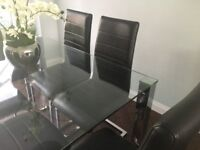 Glass Top Dining Table with Brown Faux Leather Chairs