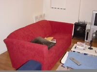 2x SOFAS FOR SALE. £25 each. Red triple sofas. Available individually or as pair