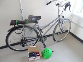 Dutch style bicyclde with pump and helmet and lights
