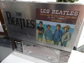 PRISTINE- LES BEATLES TAXI, T SHIRT AND WALL PLAQUE IN TIN UNOPENED