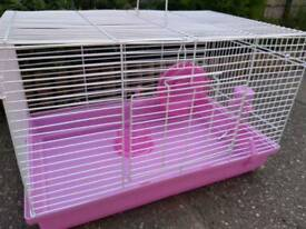 Pink hamster cage with accessories