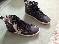 Size 4 Ladies Brand New High Top Leather Sneakers from Caterpillar