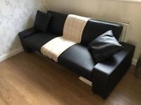 Black leather effect sofa bed