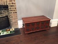 Stained teak Indonesian cabinet