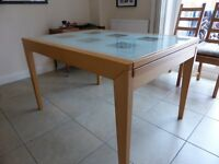 Wood framed, glass topped extending kitchen/dining table