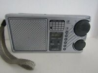 AM/FM PORTABLE POCKET RADIO WITH CLOCK & ALARM. WORKS GREAT!