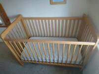 Cot, John Lewis. Mattress available if wanted. Sheets bumper and duvet included