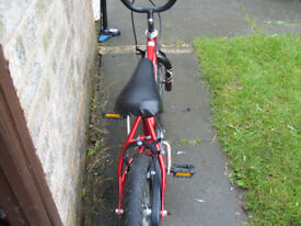 Boys cheap used first or balance bike, suit a 3 to 7 year old approx