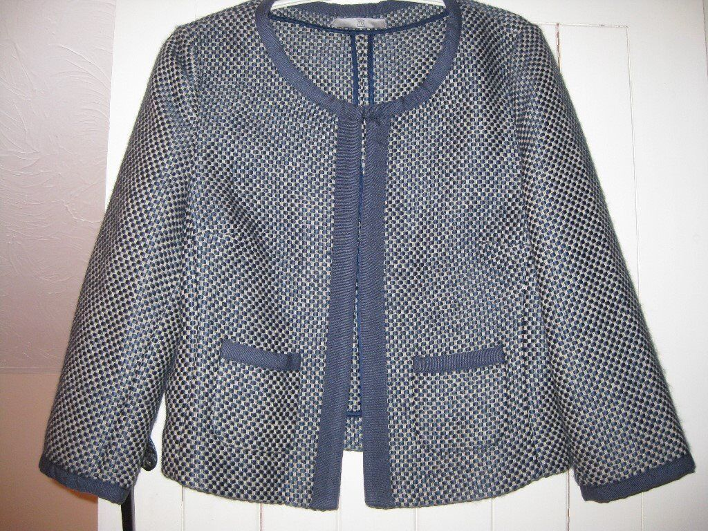 A lovely edge to edge blue small checked jacket size 12/14 Almost new.