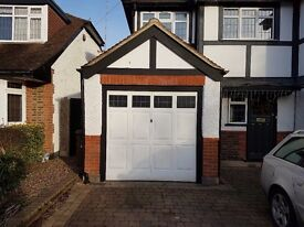 GARAGE DOOR & FRAME (White, up and over, glass windows, in good condition)