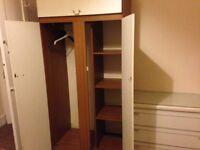 Single wardrobe hanging be side shelves other side