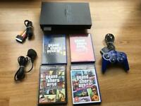 PlayStation 2 console with grand theft auto games. Ps2
