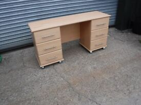 Office desk on casters with draws both ends.