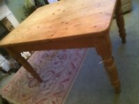 Solid Pine table, cottage style and 2 pine chairs