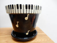 Music design hand painted pot and matching saucer for sale