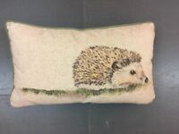 2 x hedgehog design neutral and green dunelm cushions