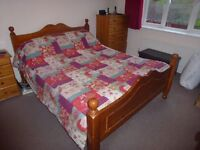 Kingsize chunky Pine Bed in very good condition with mattress if required