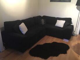 Almost new Black Fabric right hand corner Sofa Bed