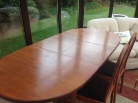 Solid wood (McIntosh) extending dining table and 6 dining chairs