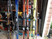 SKIS X4 PAIR POLES AND BAGS PLEASE SEE DESCRIPTION