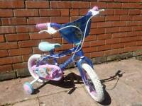 Small childs frozen bike with stabilisers