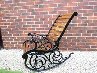 Vintage wrought iron garden rocking chair.
