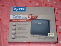 ZyXEL wireless router- brand new unopened - 3 weeks old