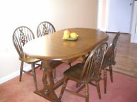 Solid oak dining table with four chairs