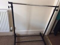 Single metal adjustable height clothes rail with wheels