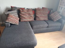 Sofa with chaise lounge and cushions