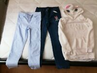 Girls jeans and a unicorn jumper, 7-8years