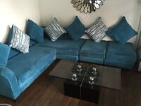 Corner Sofa with cushion & Table excellent condition. Huge saving.