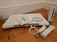 Nintendo Wii + Balance Board, Wii Fit Plus and Wii Sports Resort