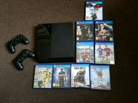 PlayStation 4 (2 controllers and games)