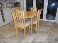 Dining Table (Extending) & 4 Chairs.