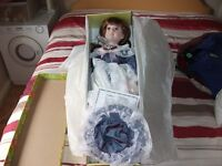 Beautiful Porcelain Doll. Never taken out of box.