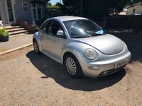 Volkswagen beetle for sale, low mileage, 1 year, good service, drives perfect.