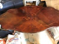 Coffee table in antique brown colour with scratches on top best to cover with table cloth or restore