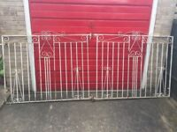 Large wrought iron gates pair for sale originally in white. Good condition