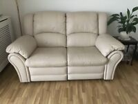 2 seater cream leather sofa and matching footstool