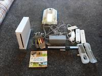 Nintendo wii, plus 2 nunchuck and nunchuck charger pack