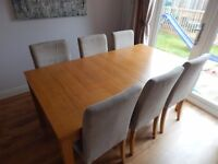 Solid wood extending dining table plus 6 chairs.
