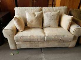 Patterned fabric two seater sofa with pull out bed