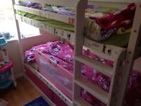 white bunk bed with mattresses