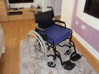 Mobility wheelchair in perfect condition folds to fit in boot of car, includes extra cushion.