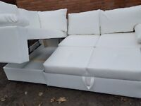 Stunning BRAND NEW white faux leather corner sofa bed with storage.delivery available